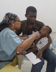Dr. Dominique Matthews with a patient
